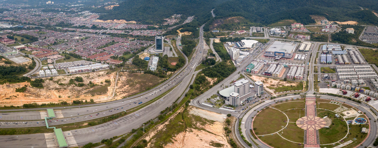 Aerial View - Busy Highway cutting through the town of Ipoh, Malaysia. Transportation Road City Architecture High Angle View Built Structure Nature No People Outdoors Aerial View Aerial Photography EyeEm Best Shots EyeEm Selects Pattern Lines Shape Motorway Expressway Transportation Connection Malaysia Eyeam_bestshot Sunset