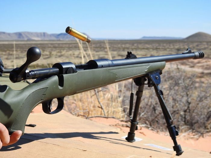 Rifle Against Clear Blue Sky During Sunny Day
