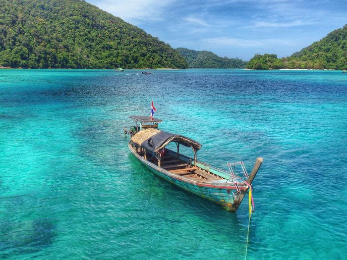 Boat In Turquoise Water