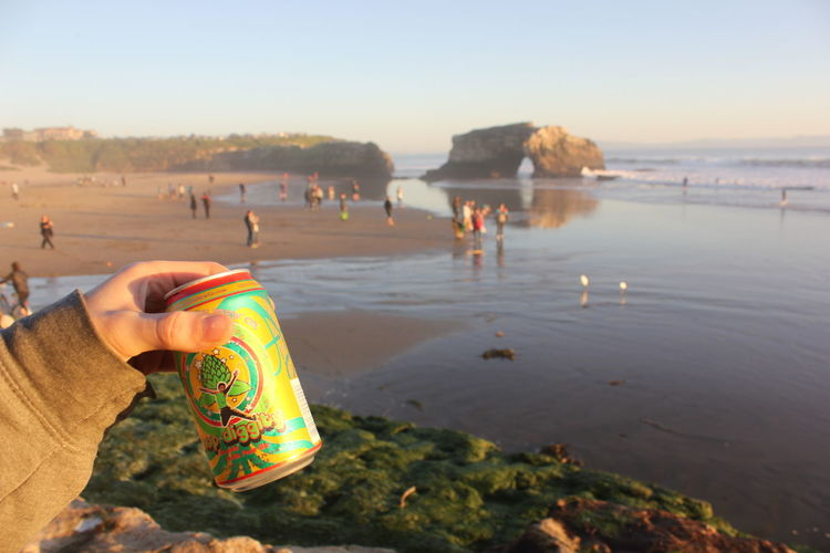 Beer Beer On The Beach Fun Santa Cruz Beach Beach Beauty In Nature Close-up Day Hand Human Hand Leisure Activity Leisure Time Lifestyles Men Nature Outdoors People Real People Sand Scenics Sea Sky Sunset Water Women Second Acts Summer Exploratorium