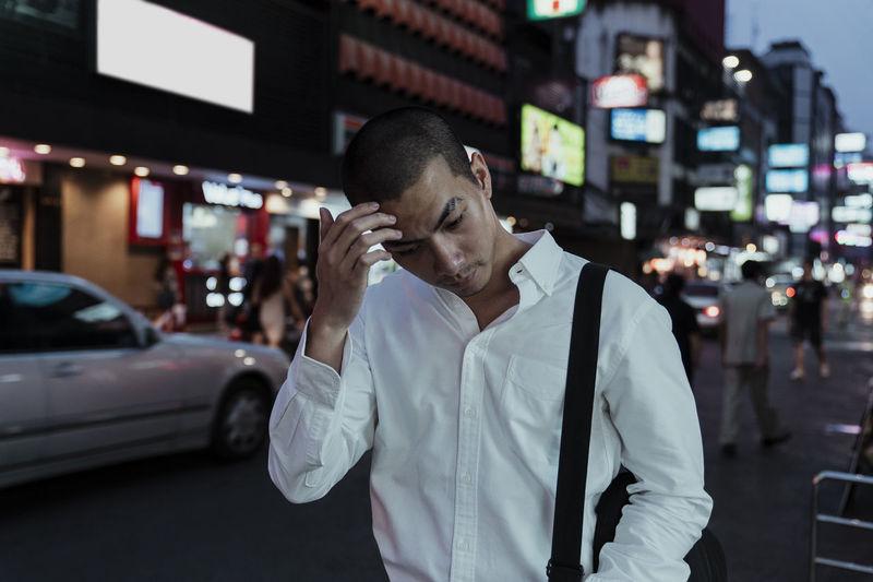 Man walking in city at night