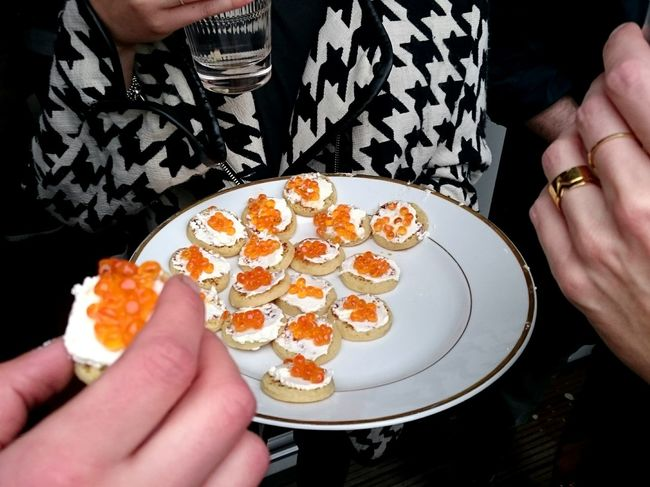 Caviar Street Food Häppchen Luxury Finger Food Ladies Food And Drink Food Adult People Plate Only Women Human Body Part Mature Adult Human Hand Adults Only Midsection Eating Ready-to-eat One Person Sweet Food One Woman Only Lifestyles Freshness Women