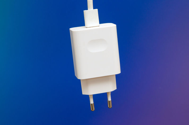 Close-up of electric lamp against blue background