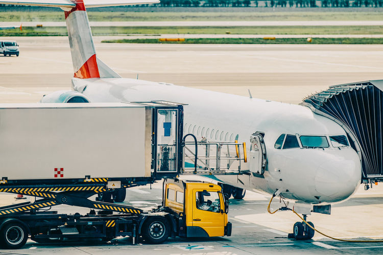 Transportation Airport Mode Of Transportation Air Vehicle Airport Runway Airplane Travel Day Passenger Boarding Bridge Runway Outdoors Land Vehicle Nature Commercial Airplane Public Transportation Aircraft Wing No People Sunlight Aerospace Industry Road