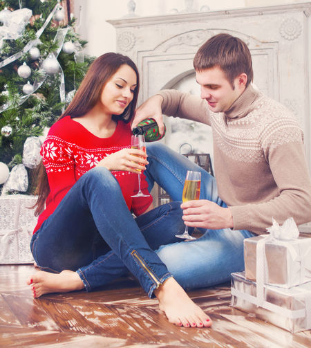 Young couple sitting in a drinking glass