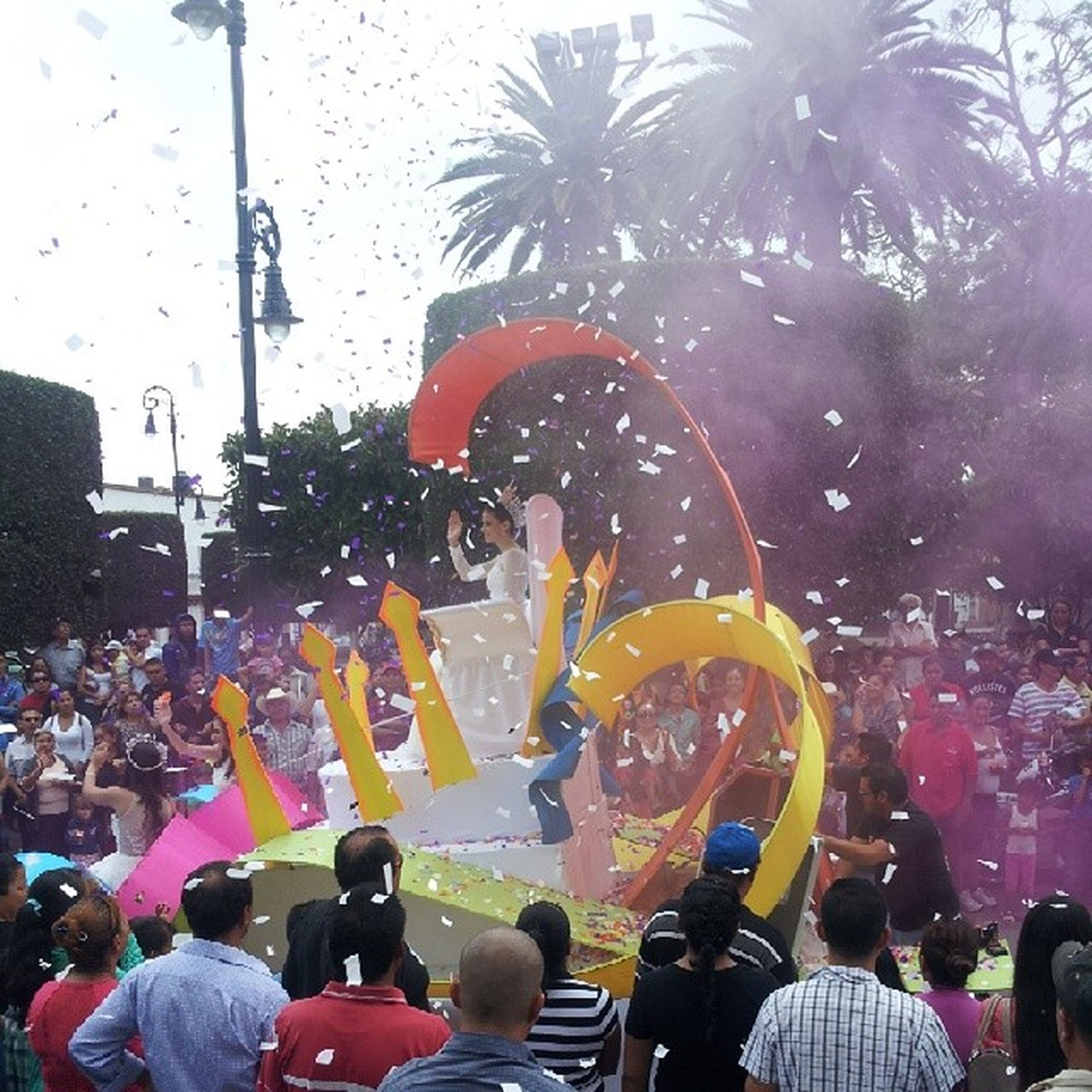 lifestyles, large group of people, crowd, leisure activity, men, togetherness, enjoyment, person, fun, arts culture and entertainment, street, performance, event, celebration, illuminated, spectator, standing, tree