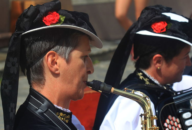 Music Traditional Clothing Accordéoniste Cap Germany Musician Playing Red Flowers Sax Player St Maergen Summer 2013