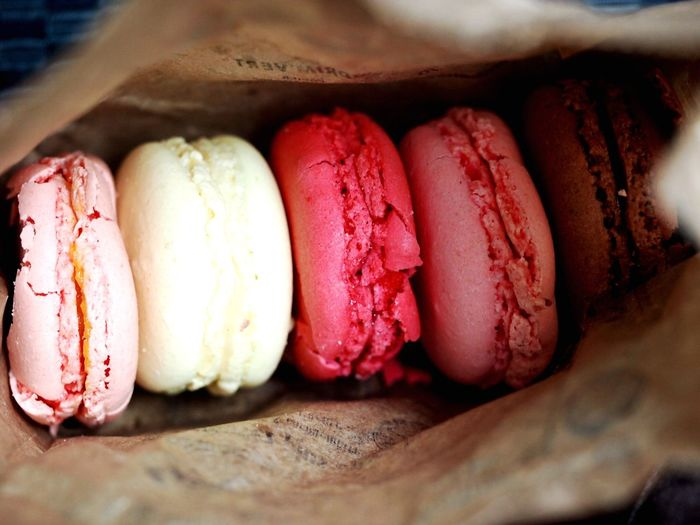 Close-up of french macaroons in paper bag