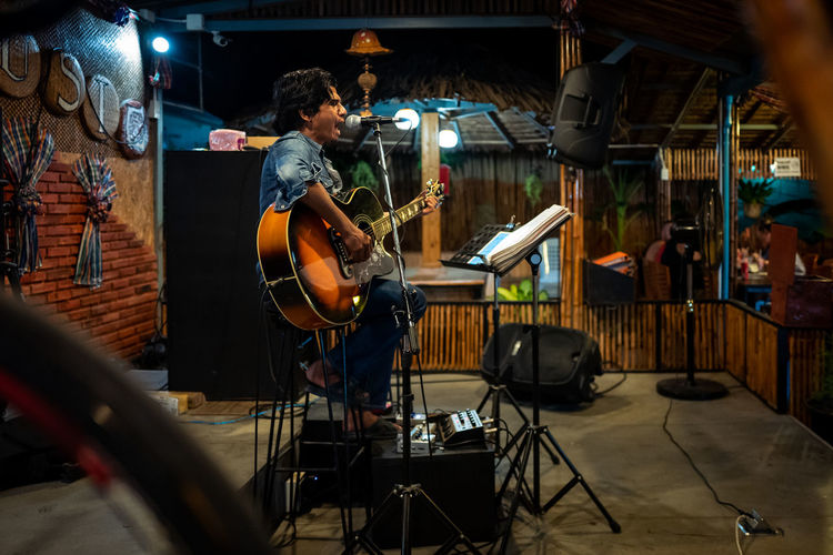 Koh Lipe Musical Instrument Music Musical Equipment Real People Musician Artist Skill  Arts Culture And Entertainment One Person Indoors  Guitar String Instrument Men Occupation Young Adult Guitarist Standing Performance Equipment Drum Garage Electric Guitar Rock Music
