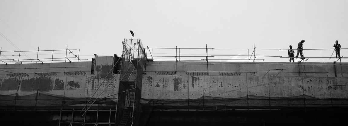 Fence Electricity  Military Outdoors Day Sky No People Architecture Blackandwhite Black & White Black And White Photography City Life Low Angle View Flyovers Flyover Construction Work Construction Construction Site Workers And Construction Workers Workersonduty