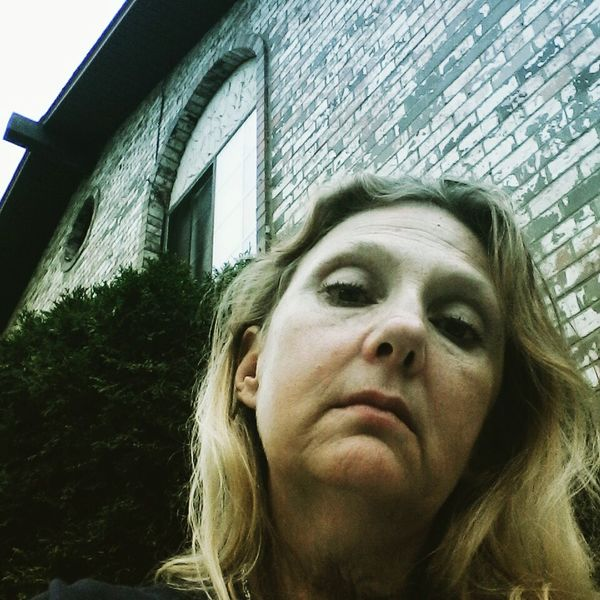 Adult Headshot Looking At Camera One Person Built Structure Showing Emotion Low Angle View Lonley And Sad The Portraitist - 2017 EyeEm Awards Snapshots Of Life Sadness Outdoors