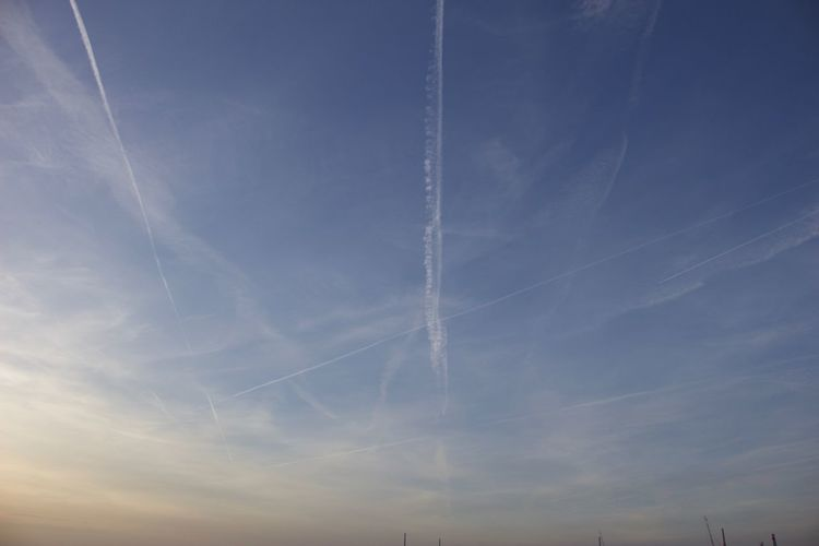 Vapor Trail Low Angle View Contrail Nature Sky Beauty In Nature No People Scenics Outdoors Day Blue Backgrounds
