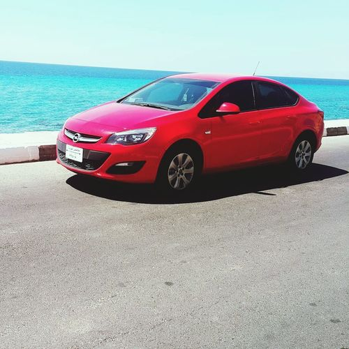 Taba Egypt Car Red Transportation Beach Sand Land Vehicle Day No People Outdoors Sky Opel Astra Opel