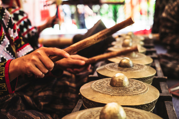 Artist's hands playing klintang/kulintang or percussion in the southern part of the Philippines. Artisan Artist Native Philippines Tribal Art And Craft Backgrounds Ethnic Finger Hand Hitting Holding Human Body Part Human Hand Lifestyles Melody Music Musicians Occupation One Person Percussion Real People Selective Focus Skill  Women 10 The Photojournalist - 2018 EyeEm Awards The Traveler - 2018 EyeEm Awards The Creative - 2018 EyeEm Awards The Street Photographer - 2018 EyeEm Awards #urbanana: The Urban Playground Summer In The City Autumn Mood The Modern Professional This Is Natural Beauty A New Perspective On Life Moments Of Happiness Analogue Sound International Women's Day 2019 My Best Photo The Art Of Street Photography
