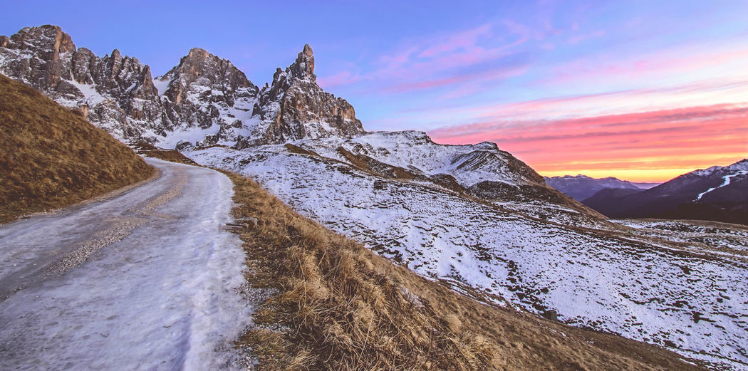Burning sky. Snow Mountain Winter Landscape Cold Temperature Road Scenics Mountain Peak Outdoors Sunset Beauty In Nature Sky Nature Day Colors Blue Hour Light Travel Destinations Alps Adventure in Trentino Alto Adige Trentino  Dolomites, Italy Pale Di San Martino