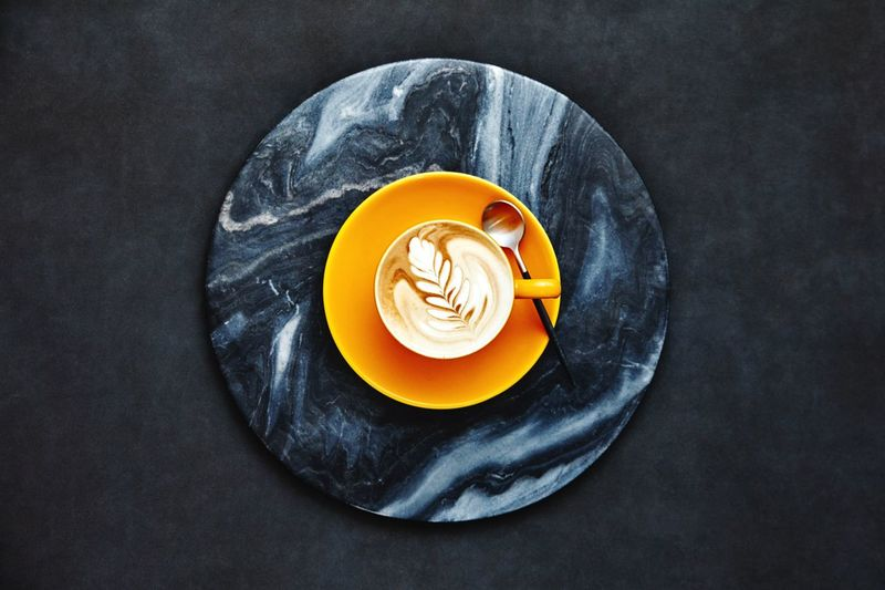 Latte art Rosetta Coffee Food Still Life Espresso Cappuccino Yellow Barista Food And Drink Minimalistic Indoors  Coffee Cup Freshness Plate Rosetta Sweet Food Directly Above EyeEmNewHere Indoors  Table No People High Angle View Refreshment Drink Ready-to-eat Wellbeing Close-up Healthy Eating Coffee - Drink Design Cup Black Background Temptation