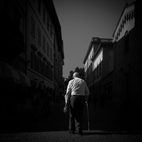 The Street Photographer - 2017 EyeEm Awards Street City Adult People Outdoors Only Men Light And Shadow Shadow Street Life Real People Life City Streetphotography BYOPaper!