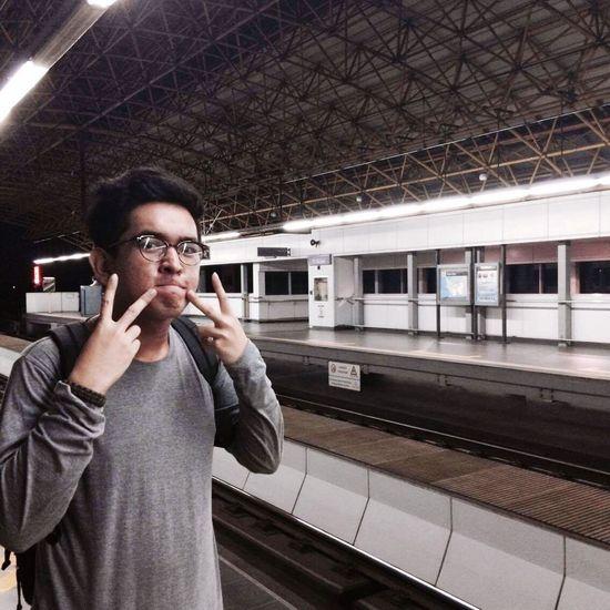 Portrait of man gesturing at subway station