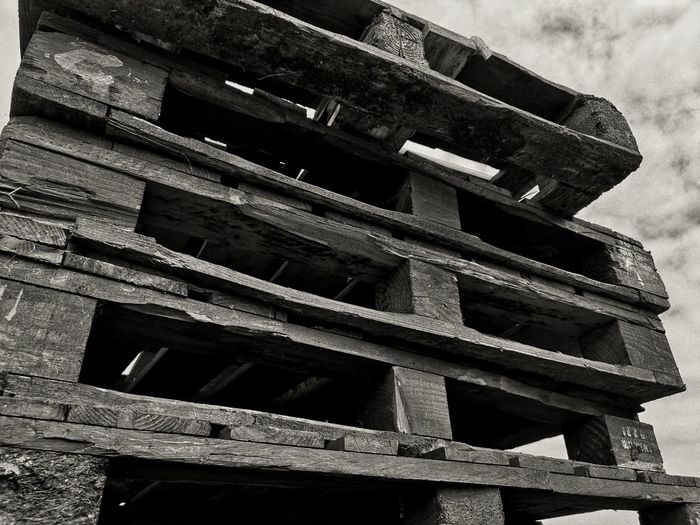 Tower of pallets Wooden Pallet Pallets Damaged EyeEm Gallery EyeEm Best Shots Eyeem Clouds And Sky Rubbish Recycle Urbanphotography Black & White Monochrome Huawei P20 Pro Huawei P20 Pro Photography Architecture Built Structure Sky Construction Pattern Weathered Deserted Urban Scenery Bad Condition