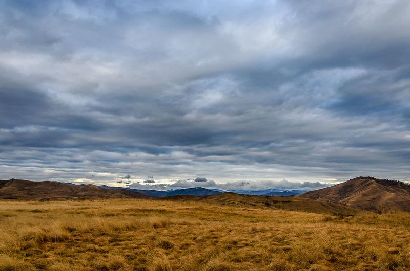 Blue Brown Cloud - Sky Clouds Cloudscape Horizon Over Land Land Landscape Outdoors Sky Tranquil Scene Yellow