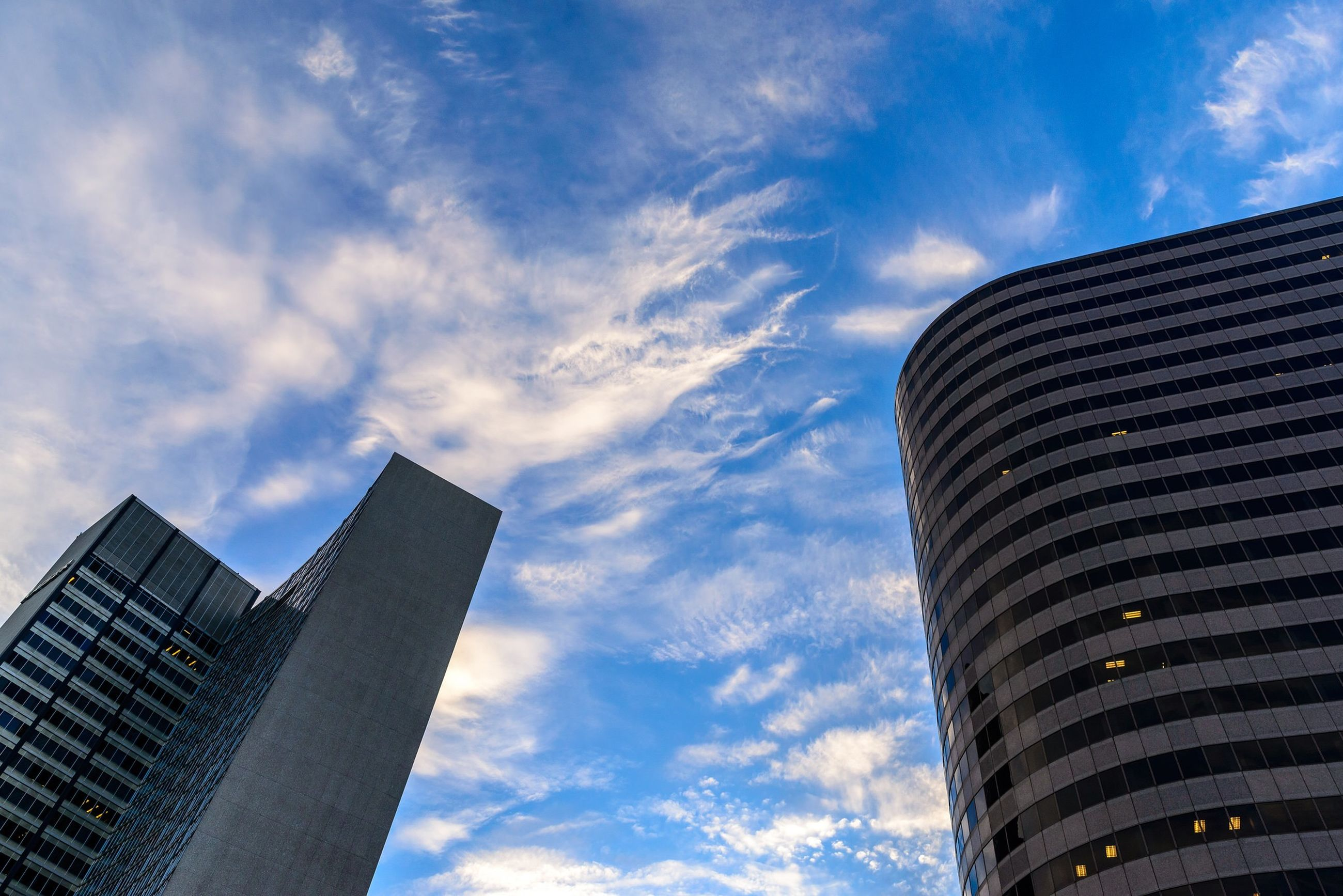 building exterior, architecture, built structure, low angle view, skyscraper, city, sky, tall - high, modern, office building, tower, cloud - sky, building, cloud, cloudy, tall, day, outdoors, city life, no people