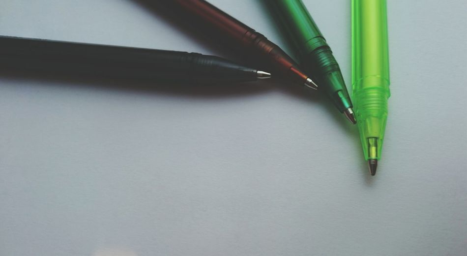 Close-up of ballpoint pens on table