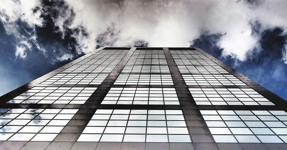 Architecture Built Structure Skyscraper Building Exterior Reflection RISK Cloud - Sky No People Day Outdoors City Beauty In Nature Travel Destinations Streetphotographer Streetphotography Amateurphotography Photography Social Issues Business Sky Office City People Illuminated