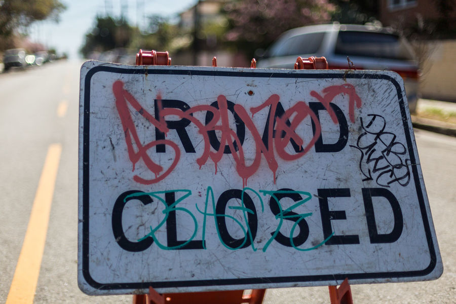 Road closed sign Car Close-up Communication Construction Construction Site Construction Work Day Detour Focus On Foreground Graffiti Morning No Entry No People Outdoors Road Road Blocked Road Blocked Off Road Closed Sign Road Sign Street Text