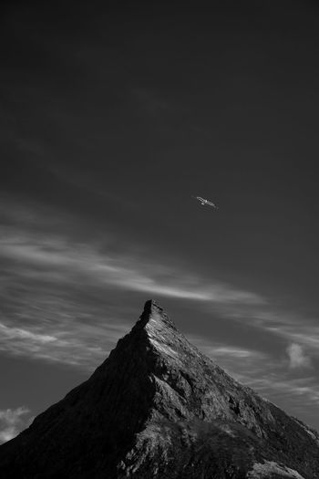 Lofoten Bnw Lofoten Mountains Norway Tourist Bird Minimalism Minimalistic Sky Mountain Flying Beauty In Nature Cloud - Sky Scenics - Nature Nature Outdoors Travel Mountain Range Non-urban Scene Low Angle View Mid-air