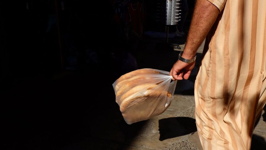 Bread Is Life Culture Morocco Tangier Moroccan Bread Moroccan Bread One Person Midsection Real People Holding Human Body Part Lifestyles Human Hand Hand Outdoors Sunlight Bag The Street Photographer - 2018 EyeEm Awards