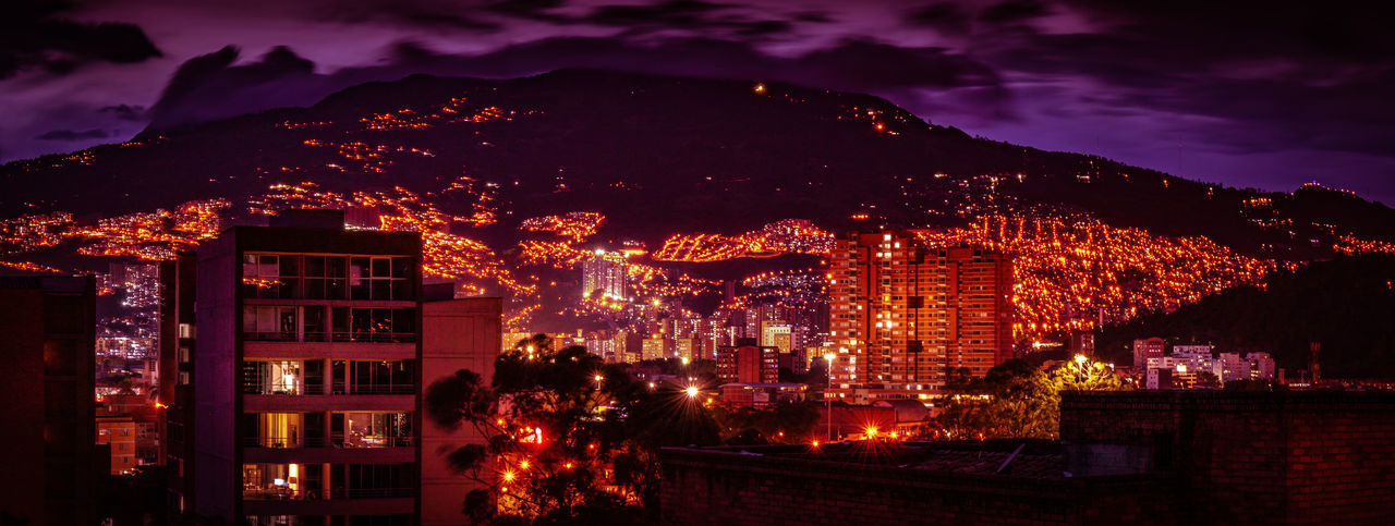 architecture, building exterior, night, built structure, illuminated, city, building, nature, sky, cloud - sky, no people, cityscape, mountain, outdoors, residential district, dusk, house, tree, glowing