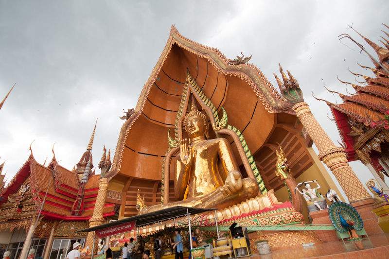 Architecture Buddha Buddha Image Buddha Statue Buddha Statues Buddha Temple Buddhastatue Building Exterior Built Structure Day Gold Colored Human Representation Low Angle View Outdoors Place Of Worship Real People Religion Sculpture Sky Spirituality Statue Temple Temple - Building Temple Architecture Temples