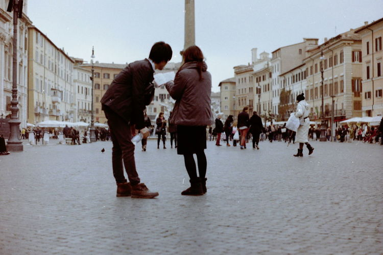 Square City Street Piazza Navona Tourism Tourist City Map Exploring Urban Exploration Travel Symmetry Pavement Streetphotography Italian City Ordinary People People Film Photography Real People Couple Warm Clothing City Young Women Winter Cold Temperature Women Togetherness Young Men Town Square Old Town Visiting The Art Of Street Photography The Street Photographer - 2019 EyeEm Awards