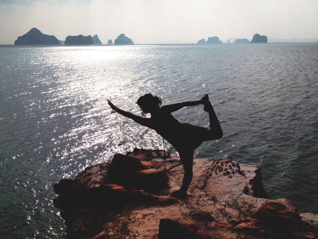 Beauty In Nature Getting Away From It All Horizon Over Water Idyllic Leisure Activity Lifestyles Nature Ocean Outdoors Remote Rock Rock Formation Scenics Sea Secret Beach Silhouette Silhouette Sky Thailand Tranquil Scene Tranquility Vacations Water Yoga At The Beach Yoga Pose