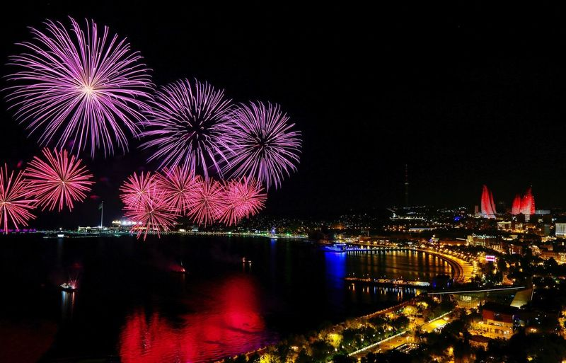 Night Illuminated Firework Display Celebration Firework - Man Made Object City Architecture Arts Culture And Entertainment Built Structure Cityscape Building Exterior Outdoors No People Multi Colored Sky City Scape Visit Azerbaijan Beautiful Baku Baku City Caspian Sea The Traveler - 2018 EyeEm Awards
