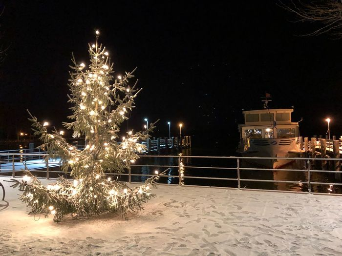 Christmas Chiemsee Lake Bavaria Ship Night Illuminated Nature Architecture Celebration Sky Built Structure No People Building Exterior Tree Land Holiday Snow Water Outdoors Building Beach Cold Temperature Motion