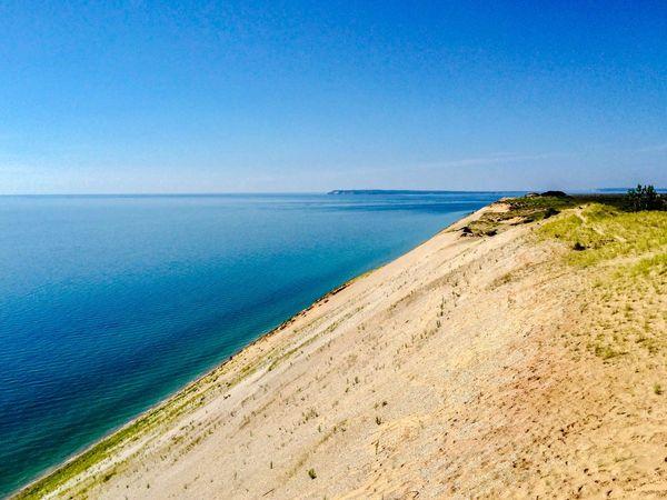 Overlooking Lake Michigan from Sleeping Bear dunes EyeEmNewHere EyeEm Selects Sea Water Beach Sky Land Beauty In Nature Scenics - Nature Idyllic Tranquility Horizon Over Water Sand