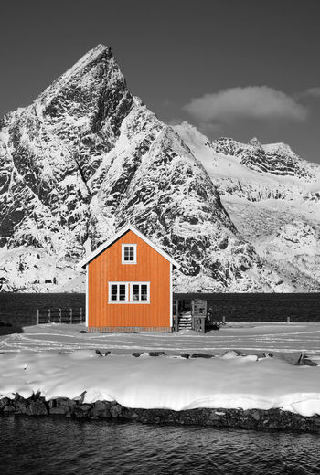 Lofoten Islands, Norway Norway Paint The Town Yellow Winter Wintertime Architecture Beauty In Nature Black And White Blackandwhite Building Exterior Built Structure Cold Temperature Day House Lofoten Mountain Nature No People Outdoors Sky Snow Snowcapped Mountain Winter Yellow