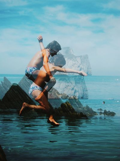 Double exposure image of girl jumping into sea