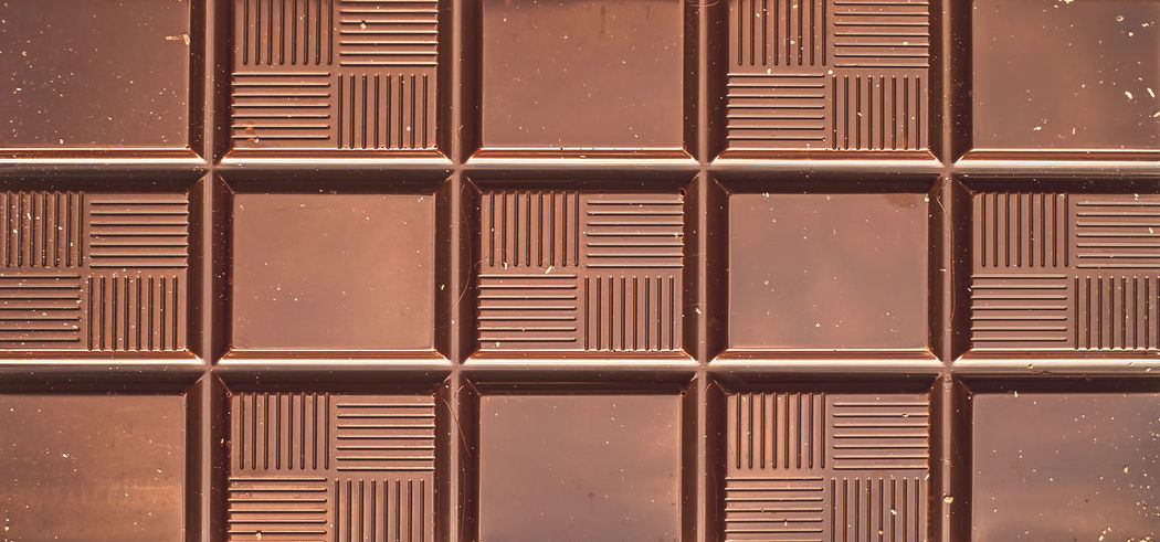 chocolate bar closeup view Chocolate Chocolate♡ Backgrounds Close-up Corrugated Iron Day Food Full Frame Illuminated Metal No People Outdoors Pattern Tablets Textured  Window