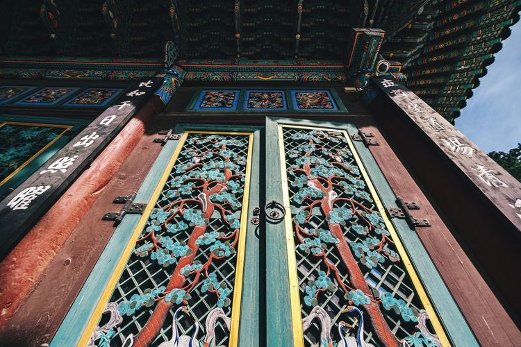 Low angle view of patterned door of buddhist temple