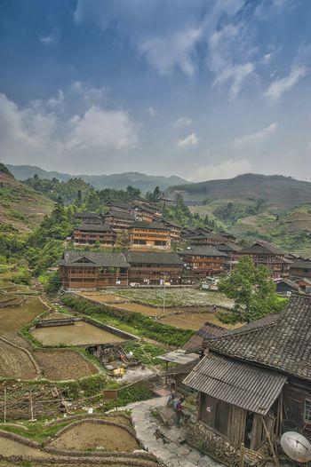 Built structures against mountain range