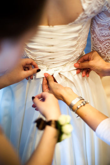 Adult Bride Celebration Close-up Day Holding Human Body Part Human Hand Indoors  Men People Real People Skill  Togetherness Two People Wedding Wedding Dress Women