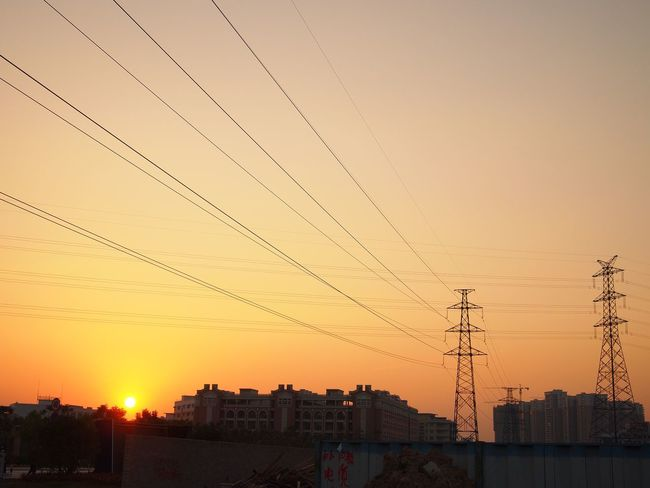 Sunset Cable Power Line  Electricity Pylon Power Supply Orange Color Building Exterior Connection Architecture Built Structure No People Electricity  Sky Silhouette Outdoors Clear Sky Technology Nature City Telephone Line