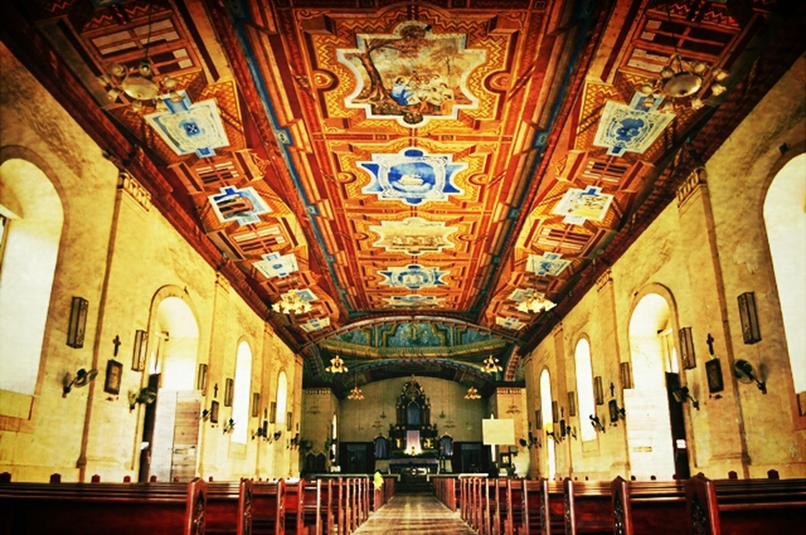 architecture, indoors, built structure, ceiling, arch, illuminated, low angle view, diminishing perspective, the way forward, ornate, architectural feature, design, interior, religion, place of worship, corridor, in a row, pattern, lighting equipment