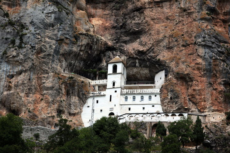 Low angle view of ostrog monastery on mountain