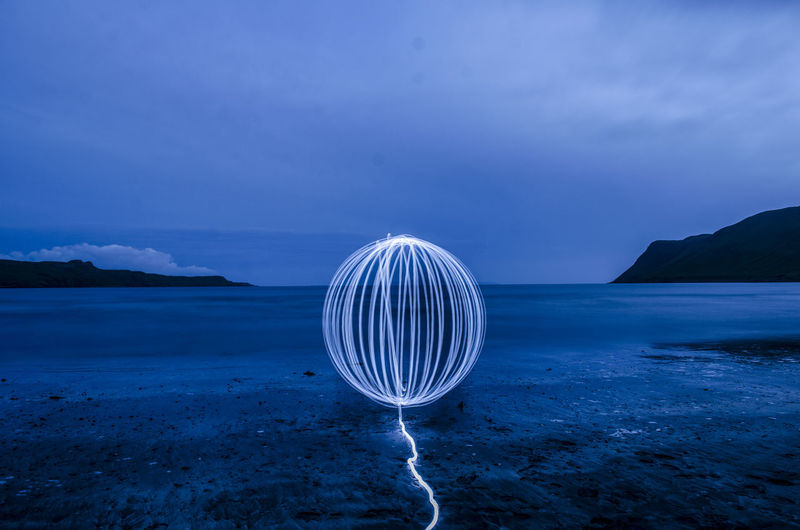 Wire wool at beach during night
