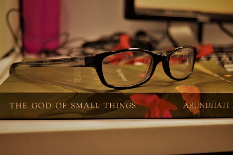 God of small things! one of the best by Arundhati Roy #Arundhati #book #bookootities #BookWorm #Godofsmallthings #mustread........  #office #Officeset #Reading, Only Because Its Good. Close-up Day Eyeglasses  Eyesight Indoors  No People Reading Reading & Relaxing Reflection Sunglasses