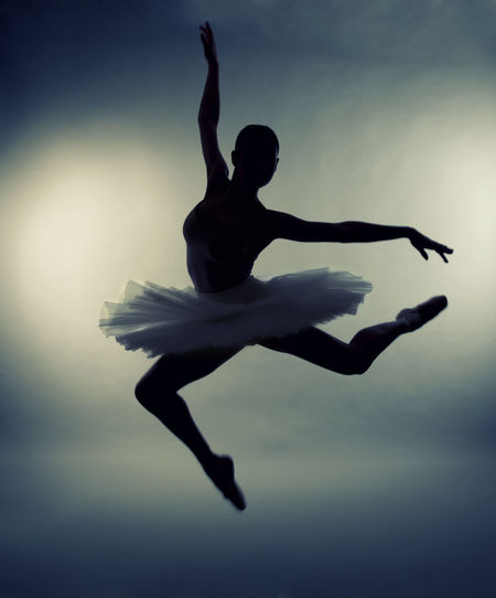 Silhouette Ballet Dancer Performing While Wearing Tutu