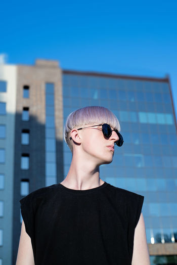 Blonde Fashion Young Youth Architecture Blond Hair Boy Building Exterior Built Structure City Day Male Modern One Person Outdoors People Portrait Sky Skyscraper Street Style Sunglasses Teen Teenager Urban Young Adult